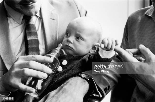 'Blue Peter' presenter Peter Purves holds 14weekold Daniel Simon Scott who will star with Purves and copresenter John Noakes in a feature on babies