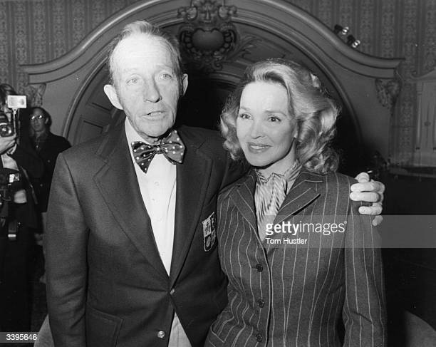 American singer and actor Bing Crosby who is now starring in a two week show at the London Palladium in town with his wife Kathryn
