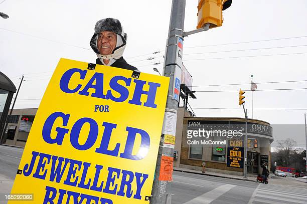 DEC 28th 2010pics of sandwich board advertising guy still walks the street for harold the jeweller even after store bombed gold and jewellry buyers...