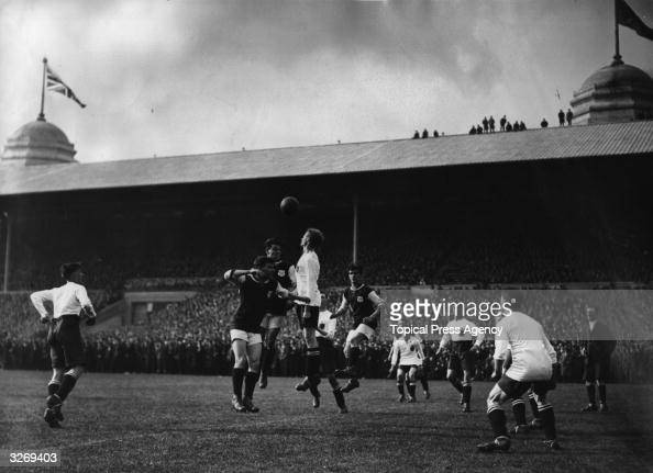 Players leap for the ball during the FA Cup Final between Bolton Wanderers and West Ham United the first held at the newly completed Wembley Stadium...