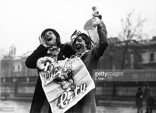 A couple of Manchester City Football Club fans voice their enthusiasm in Trafalgar Square on the day of their team's FA Cup final match against...