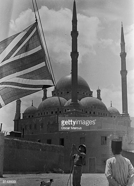 A British soldier lowering the Union Jack to half mast at the Cairo Citidal on receiving the news of the death of King Fuad