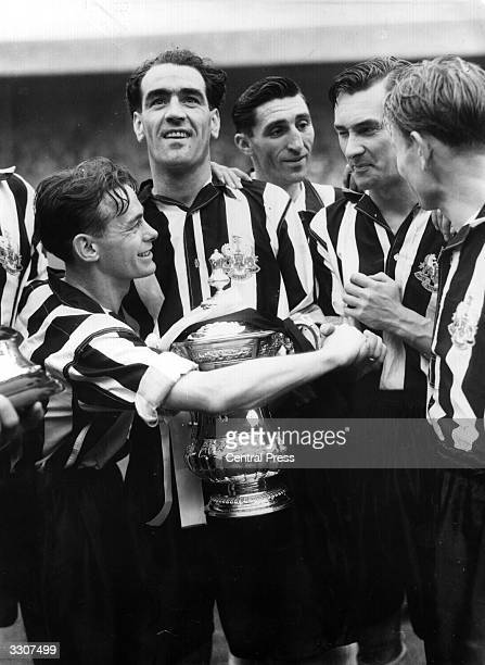 Newcastle United players celebrate their 20 win over Blackpool in the FA Cup Final at Wembley Captain Joe Harvey is with the trophy and Jackie...