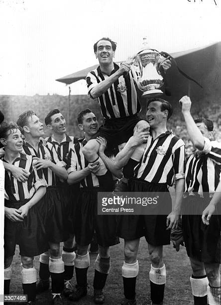 Victorious members of Newcastle United lift captain Joe Harvey on their shoulders in celebration after beating Blackpool 20 in the FA Cup Final at...