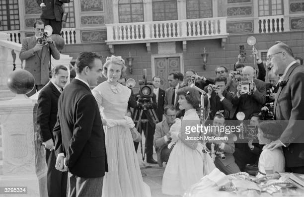 A white dove is presented to film star Grace Kelly and Prince Rainier III as a gift from the people of Monaco on their wedding day Original...