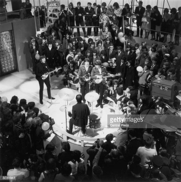 Hundreds of fans surround The Beatles during rehearsals for their own ITV programme 'Round The Beatles'