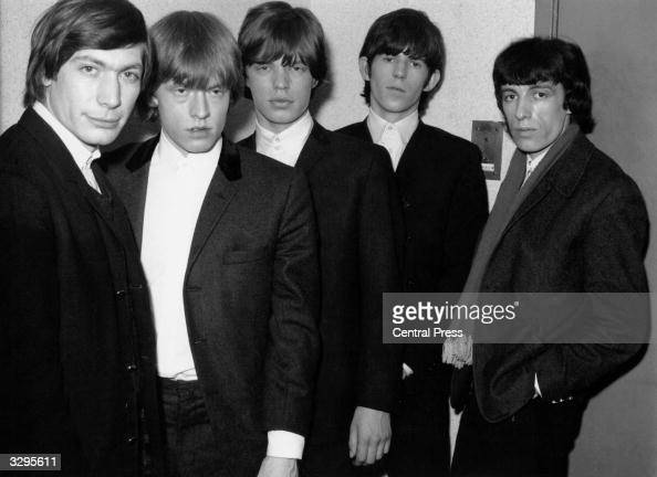 The Rolling Stones from left to right Charlie Watts Brian Jones looking a little worse for wear Mick Jagger Keith Richards and Bill Wyman backstage...