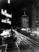 A nighttime longexposure photograph of the American centre of musical recordings at the intersection of Hollywood Boulevard and Vine Avenue in Los...