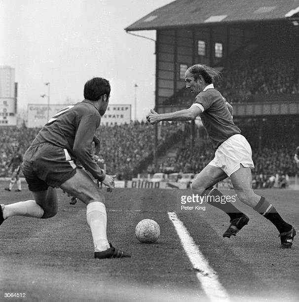 Bobby Charlton Captain of Manchester United football club in action against Ron Harris of Chelsea at Stamford Bridge It is Charlton's last game and...