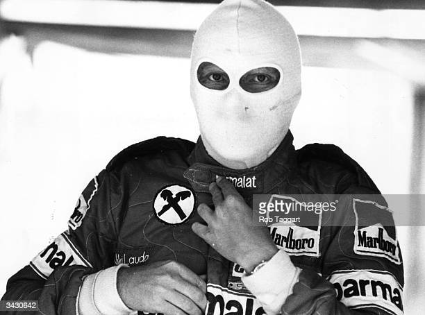 Austrian racing driver Niki Lauda wearing a protective face mask before a practice run at Brands Hatch England