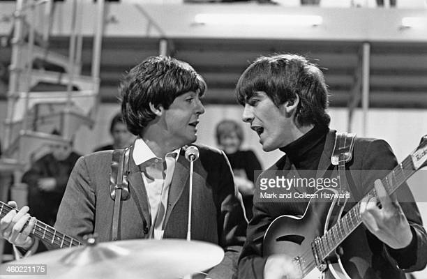 Paul McCartney and George Harrison from The Beatles perform on The 'Around The Beatles' TV special at Rediffusion's Wembley Studio in London on 28th...