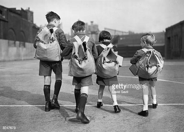 A group of siblings set off for an evacuation rehearsal at Friar Street School in Southwark