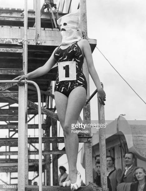 The winner of the 'Neatest Figure' competition at the Lido in Margate wearing a hood so that the judges could not be influenced by facial attributes