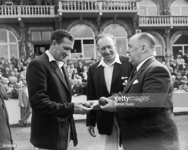 English bowler Jim Laker is presented with the two balls with which he took 9 and 10 wickets during the test match at Old Trafford