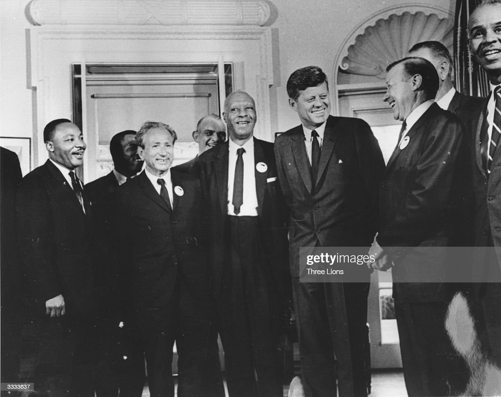 American president <a gi-track='captionPersonalityLinkClicked' href=/galleries/search?phrase=John+F.+Kennedy&family=editorial&specificpeople=70027 ng-click='$event.stopPropagation()'>John F. Kennedy</a> in the White House with leaders of the civil rights 'March on Washington' (left to right) Whitney Young, Dr Martin Luther King (1929 - 1968), Rabbi Joachim Prinz, A. Philip Randolph, President Kennedy, Walter Reuther (1907 - 1970) and Roy Wilkins. Behind Reuther is Vice-President Lyndon Johnson.