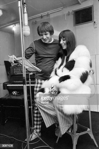 American husband and wife pop singers Sonny Bono and Cher in a recording studio during a session in aid of the Braille Institute