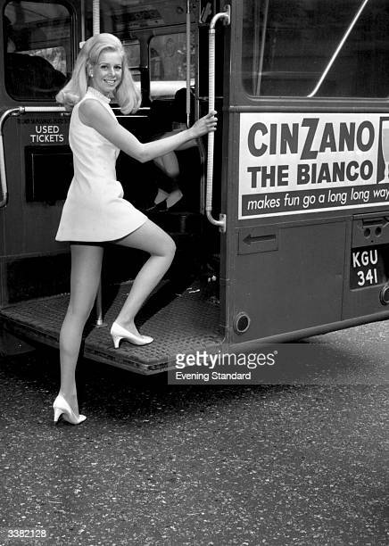Model Linda Goldstraw in a minidress getting on to a London a bus