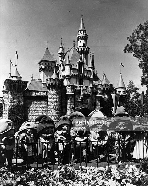 The 'Seven Dwarves' at Disneyland in front of 'The Magic Castle' in Florida