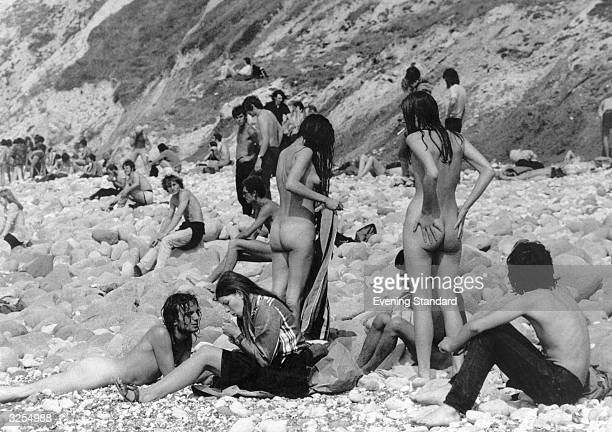 Hippies at the Isle of Wight Pop Festival strip down on the beach during a break from the music