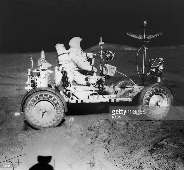 US astronaut Commander of Apollo 15 David Scott seated in the Lunar Rover after completion of extravehicular activity is returning to the lunar...