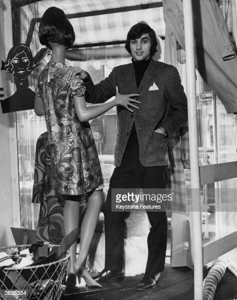 Manchester United footballer George Best poses with a mannequin in the window of his boutique situated not far from United's Old Trafford football...