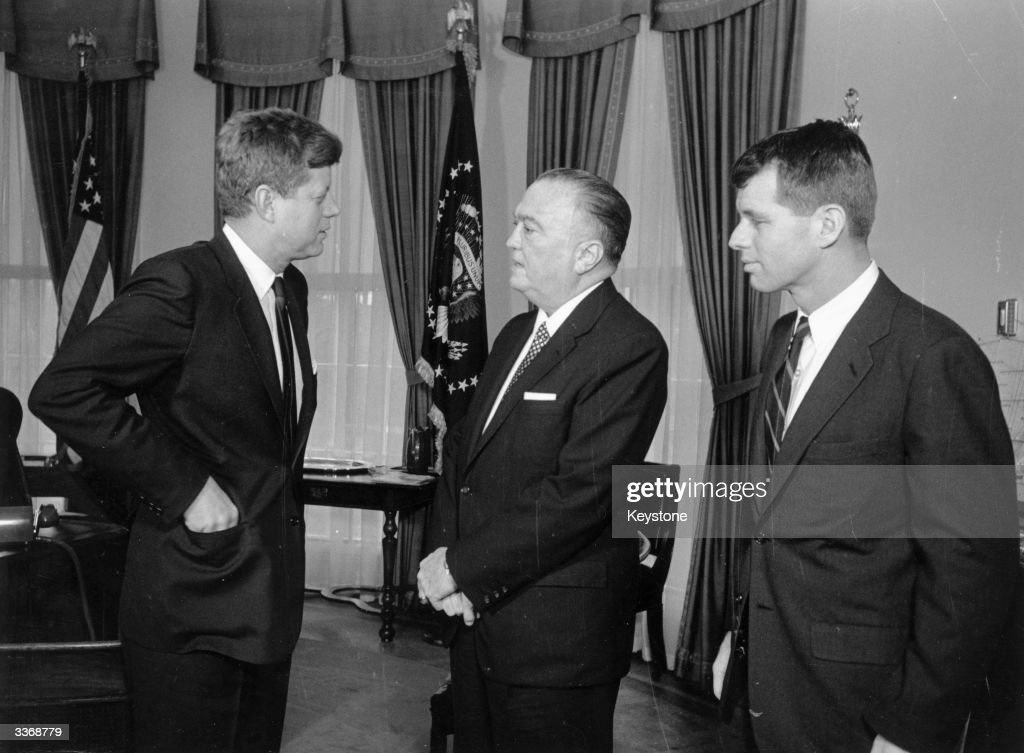 American President John F Kennedy (1917 - 1963) at the White House with his brother Attorney General <a gi-track='captionPersonalityLinkClicked' href=/galleries/search?phrase=Robert+Kennedy+-+Attorney+General&family=editorial&specificpeople=94001 ng-click='$event.stopPropagation()'>Robert Kennedy</a> (1925 - 1968) and head of the FBI J Edgar Hoover (1895 - 1972).