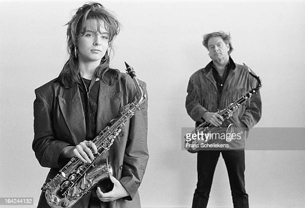 Dutch musician Candy Dulfer poses holding an alto sax with her father Hans Dulfer in a studio in Amsterdam Netherlands on 28th February 1988
