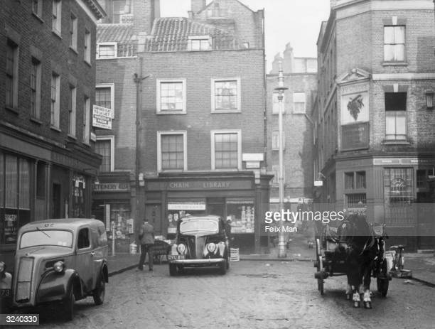 A horse and cart standing outside Ye Grapes pub in a corner of Mayfair near Shepherd's Market
