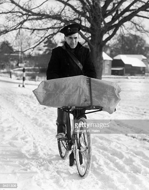 Postman J F Martin making his rounds after a heavy snow fall at Tilford in Hampshire