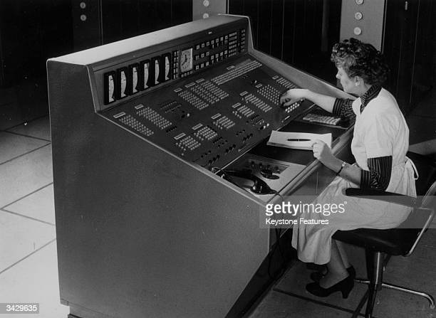 A woman operating an 'electronic brain' used by a German mail order business to open letters take details check on stock availibility and price...