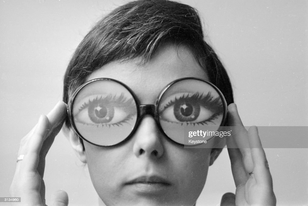 Big round glasses magnify the eyes of the model wearing fashion glasses designed by Marly, a Paris optician.