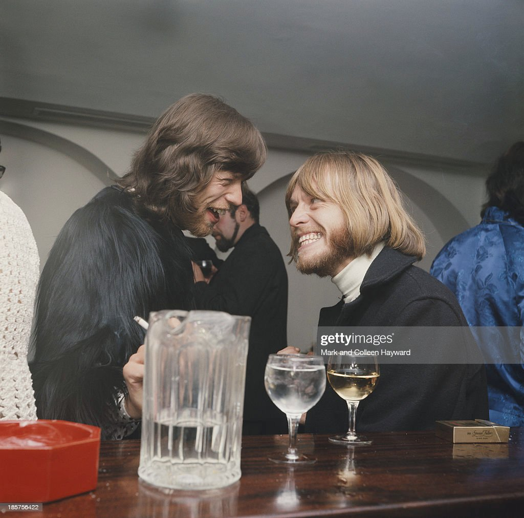 Mick Jagger and Brian Jones from The Rolling Stones talk together at a party to celebrate the cabaret debut of the Supremes on Kings Road Chelsea on...