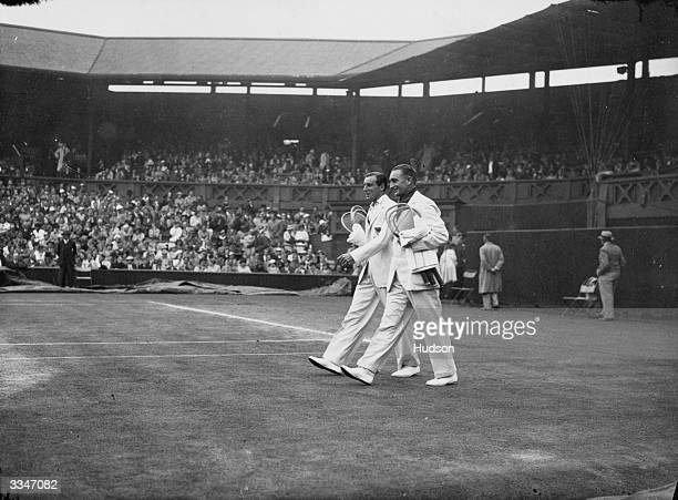 Britain's Fred Perry and Jack Crawford of Australia walking on to the centre court to decide the outcome of the Davis Cup at Wimbledon Great Britain...