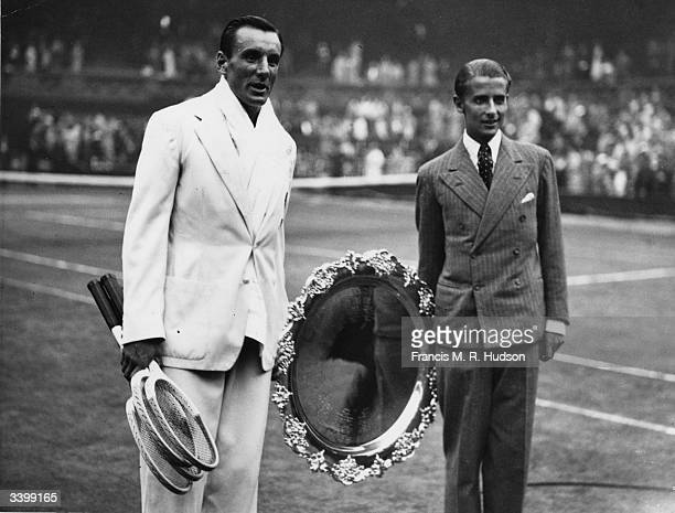 British tennis players Fred Perry and Bunny Austin with the Davis Cup shield at Wimbledon