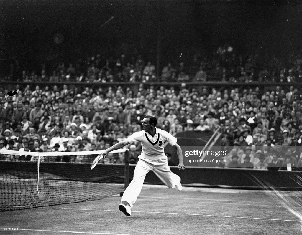 Fred Perry of Great Britain in action against Jack Crawford of Australia during their Davis Cup match at Wimbledon Britain beat Australia 32