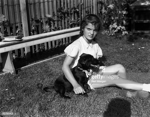 EXCLUSIVE Jacqueline Bouvier seated with her dog Tammy at the dog show at East Hampton Fair Long Island New York It was her tenth birthday The fair...