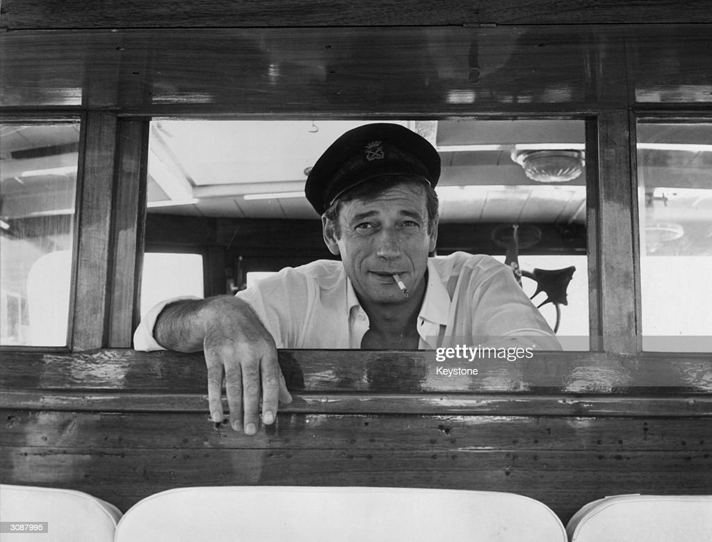 French film star Yves Montand (Ivo Livi) (1921 - 1991) on board his yacht at Cannes during a holiday on the Cote d'Azur.