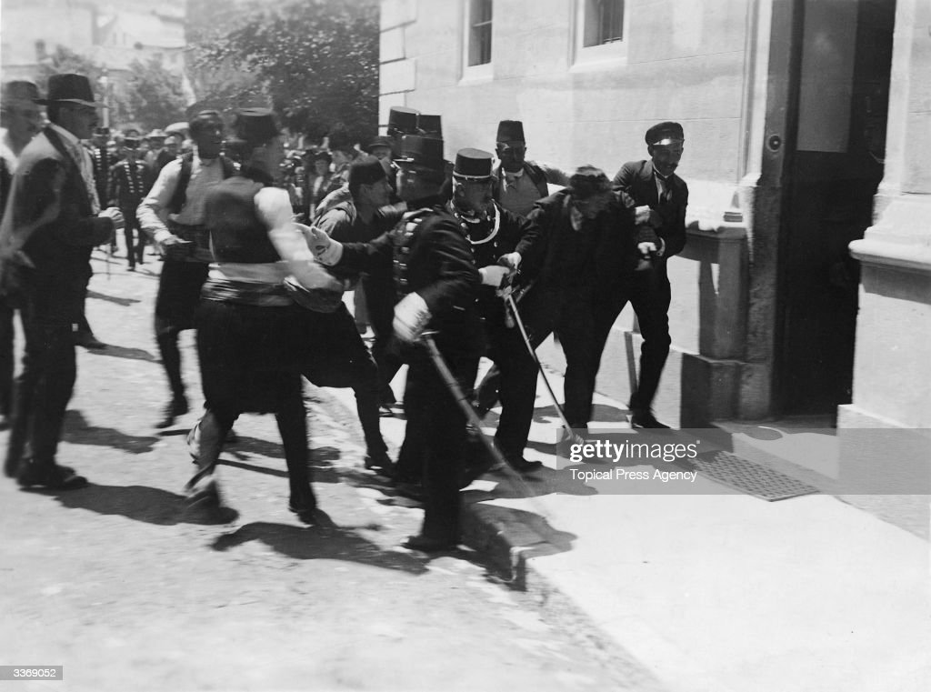 Police in Sarajevo arrest a man after a failed assassination attempt on the life of Archduke Franz Ferdinand, heir to the throne of the Austro-Hungarian Empire. The arrested man previously thought to be Gavrilo Princip, who succeeded in killing the Archduke the same day, is now thought to be one of his six co-conspirators Nedeljko Cabrinovic. The assassination was one of the causes of World War I. The moment was captured by amateur photographer Milos Oberajger.