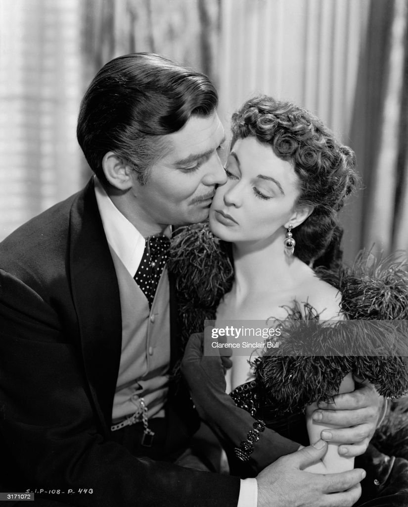 Clark Gable as Rhett Butler and Vivien Leigh as Scarlett O'Hara in the romantic epic 'Gone With The Wind' directed by Victor Fleming