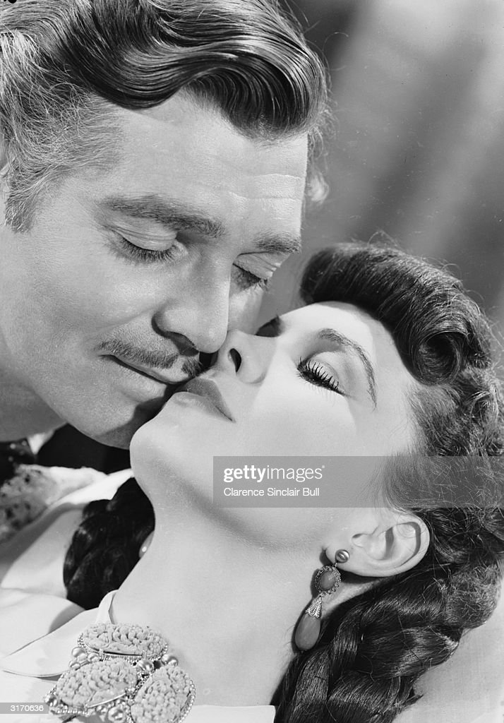 Clark Gable (1901 - 1960) as Rhett Butler with his co-star Vivien Leigh (1913 - 1967) as Scarlett O'Hara in the American civil war epic 'Gone With the Wind'.