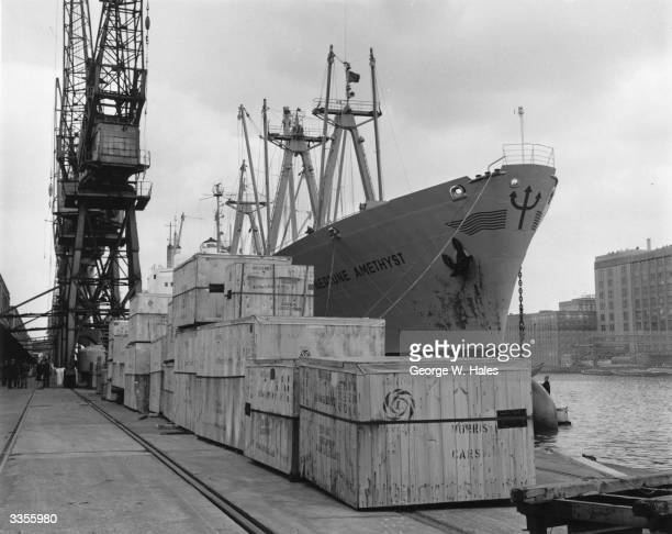 Work in progress at London's Royal Victoria Docks with British Leyland cars being loaded for export on the Neptune Amethyst
