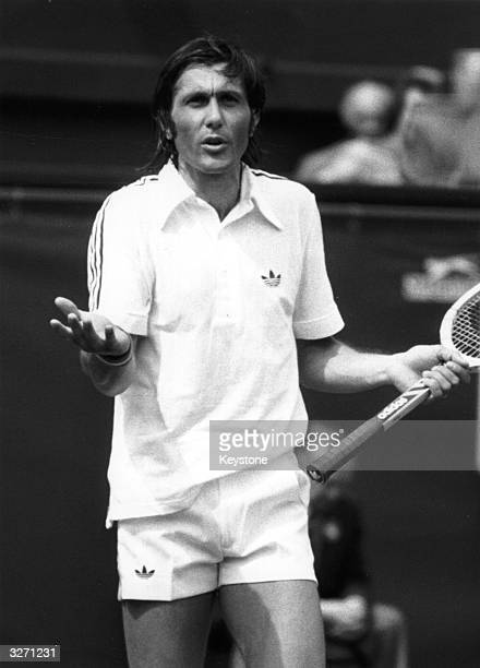Romanian tennis player Ilie Nastase disputing a decision during a match at the Wimbledon Lawn Tennis Championships