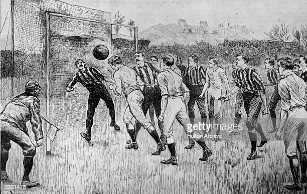 A player heading the ball towards the goal during a football match between Blackburn Rovers and Nottingham County Original Publication Illustrated...