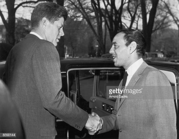 President John F Kennedy bids farewell to King Hassan II of Morocco while escorting him to his car after their meeting at the White House Washington...