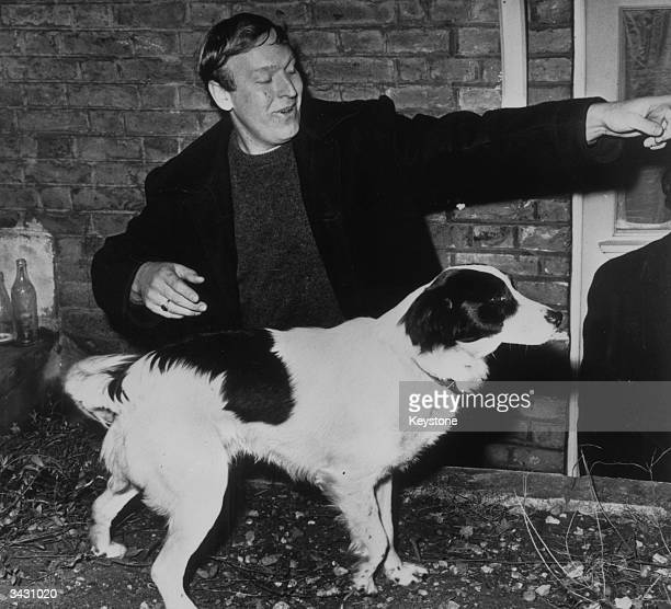 David Corbett with his dog Pickles who found the World Cup in his back garden after it was stolen before the World Cup in England eight days earlier