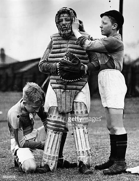 Oldham schoolboys wearing football kit dress a fellow pupil in protective clothing including cricket gear for a game of baseball
