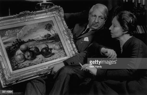Artist Giorgio De Chirico asking his wife her opinion on one of his works Original Publication Picture Post 4804 De Chirico A Haunted Painter pub 1949