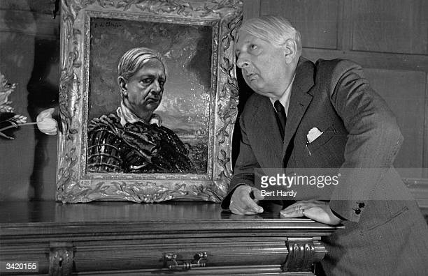 Italian painter and founder of the metaphysical school of painting Giorgio de Chirico with a selfportrait he painted 41 years ago to resemble himself...
