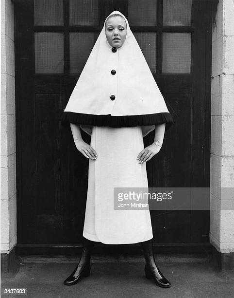 Denise Cox modelling a Pierre Cardin designed woollen dress and cape during a fashion show at Dickens and Jones