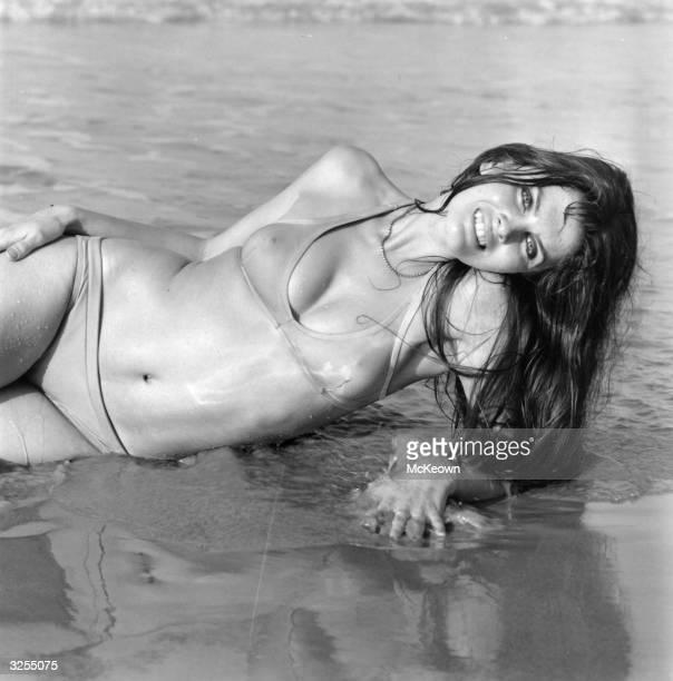 Caroline Munro modelling a bikini